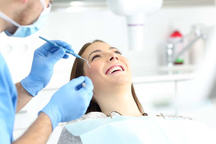 Female patient in dentists' chair