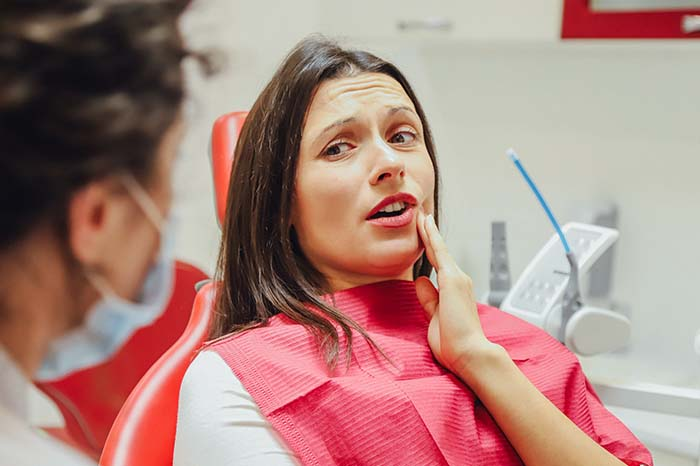 Female patient at dentist for root canal procedure