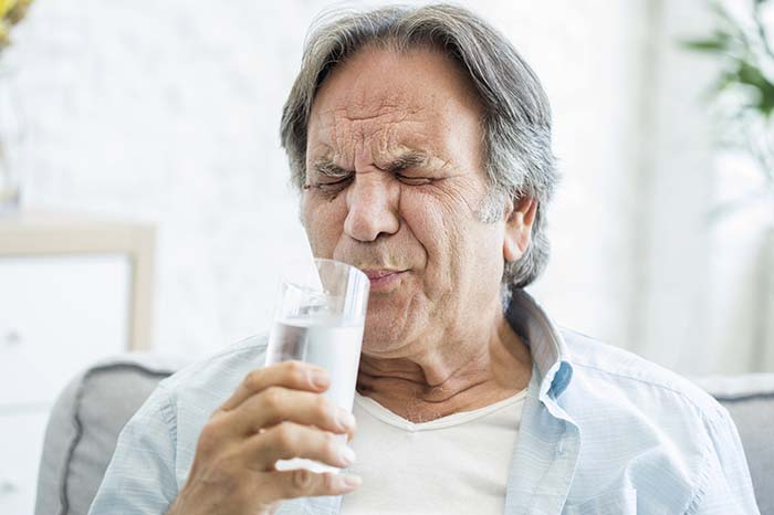 Old man with tooth sensitivity