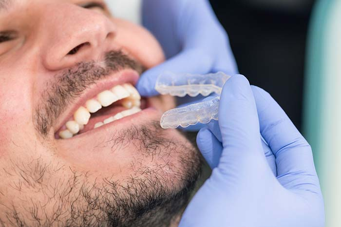 dentist performing a dental procedure on patient