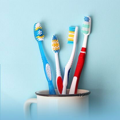 Photo of tooth brushes in a cup
