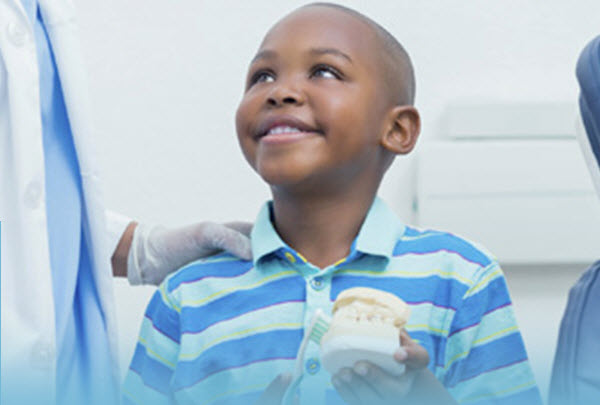 Photo of young boy smiling at his dental appointment