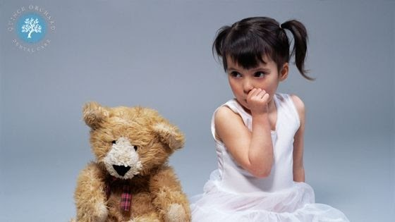 Photo of a little girl and her teddy bear