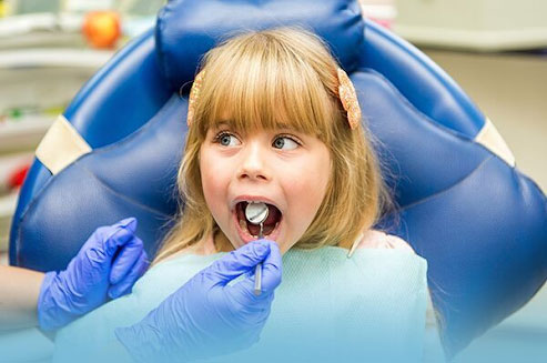 Photo of a young girl at the dentist