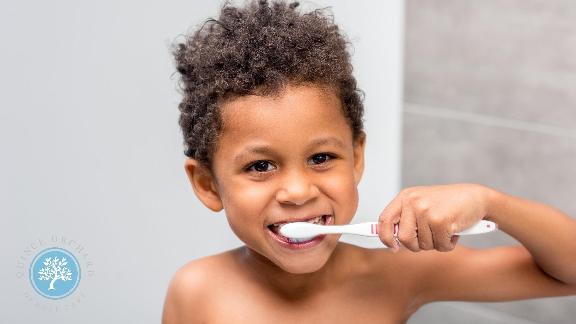Photo of boy brushing his teeth