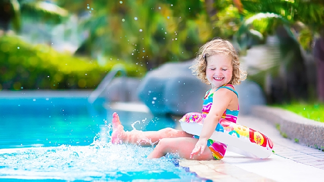 Photo of a toddler playing at the poolside